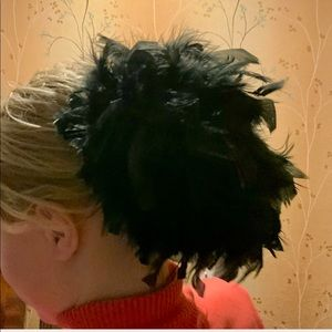 Large black ostrich barrette bun. So unique!